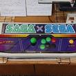 セガのゲーム機を佐賀県立図書館で展示 「SEGA」と「SAGA」一字違いで意気投合